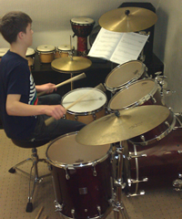 Aberdeen Drum Lessons Student playing Drum Kit